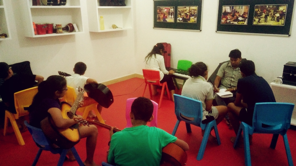 kids learning guitar and keyboard in YSIPA MUSIC CLASS.